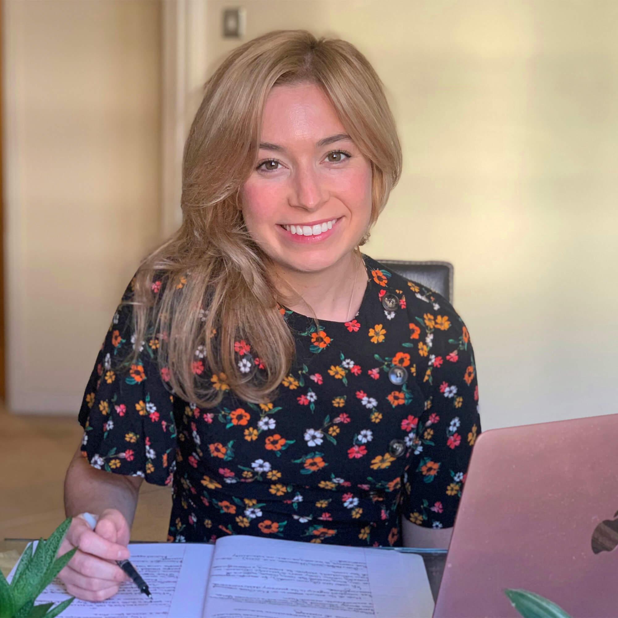 Amanda Ripley writing happily at her desk