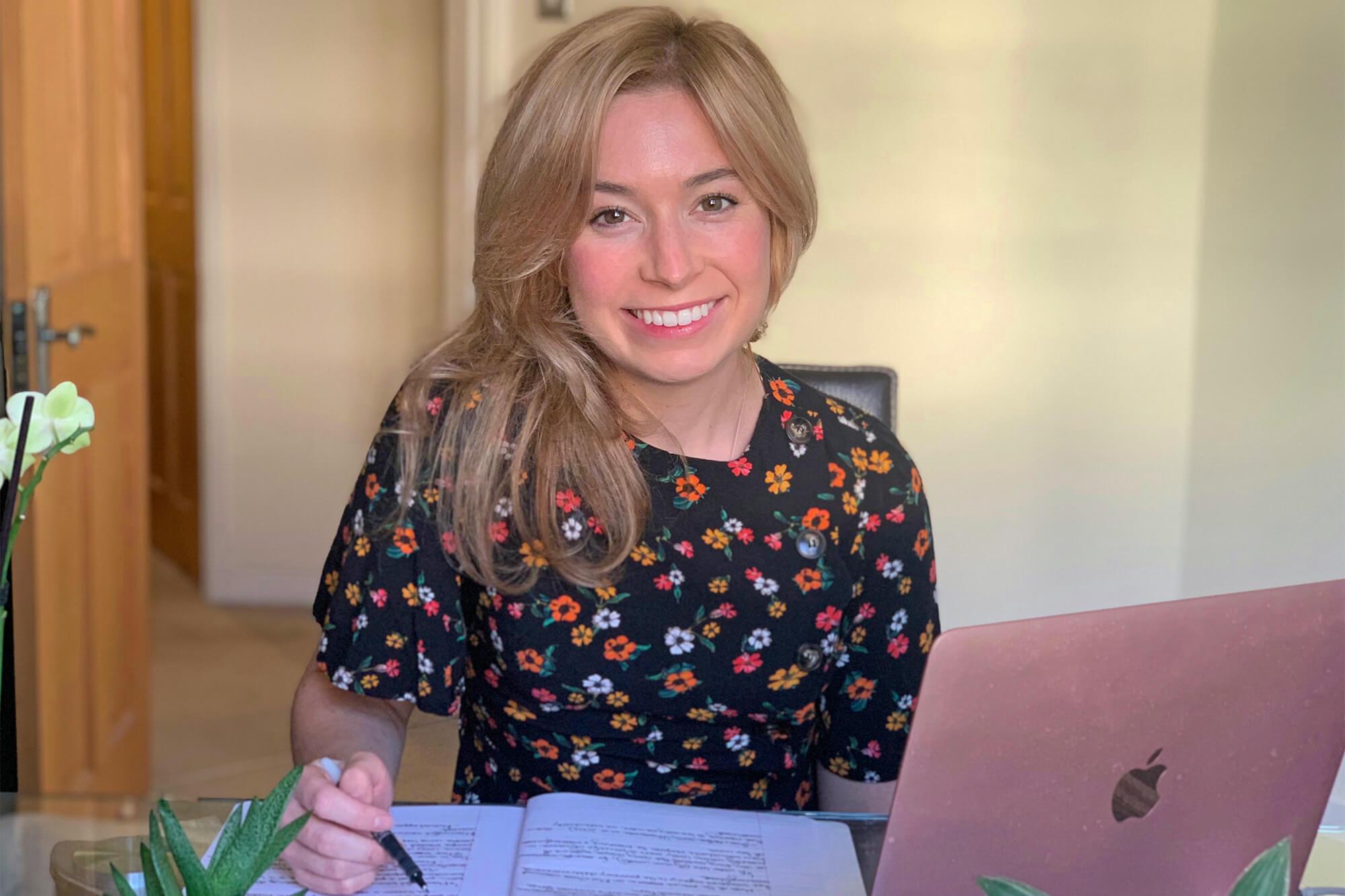 Amanda Ripley writing happily at a desk