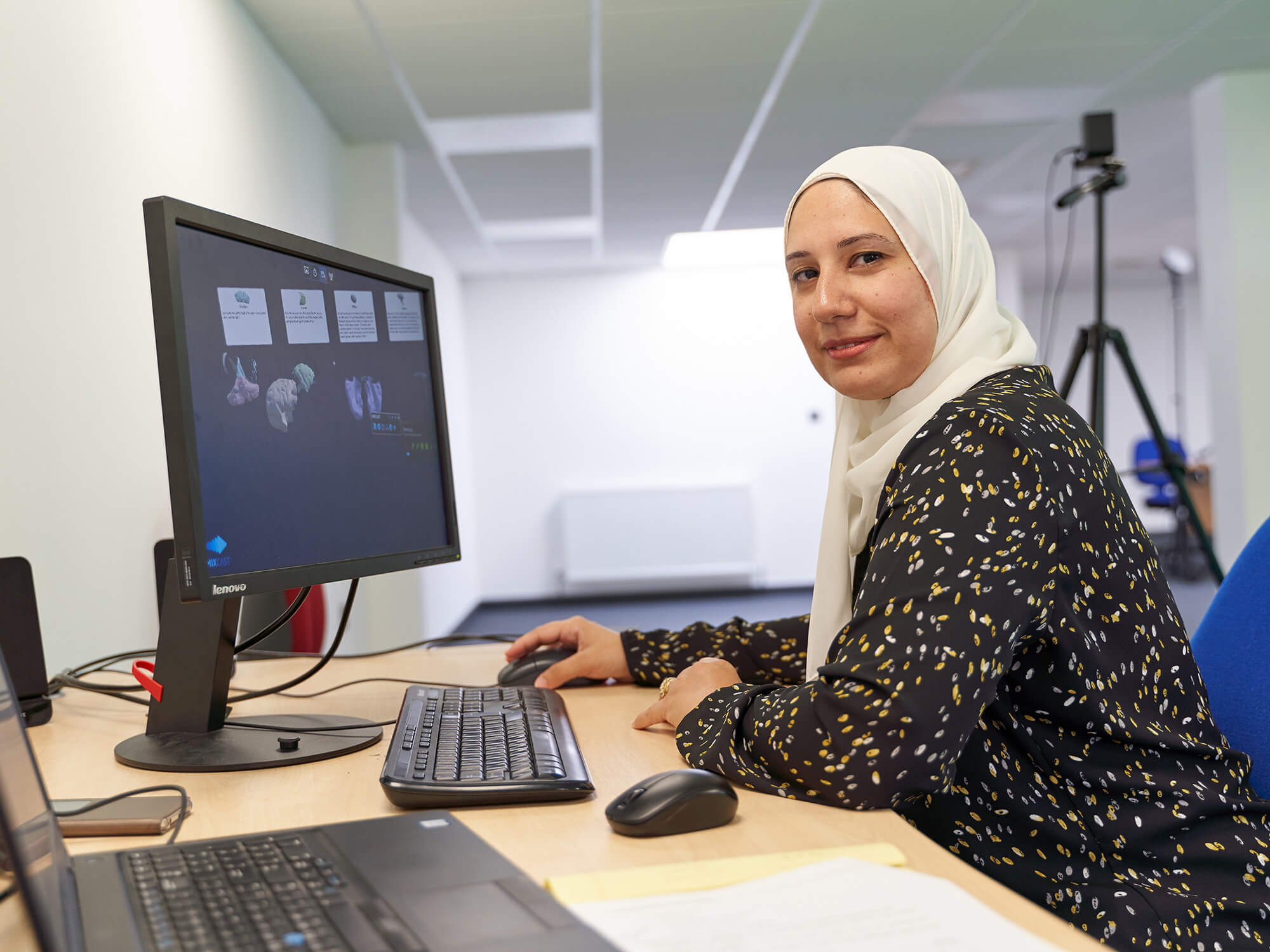 Student Asmaa Sakr sitting at computer