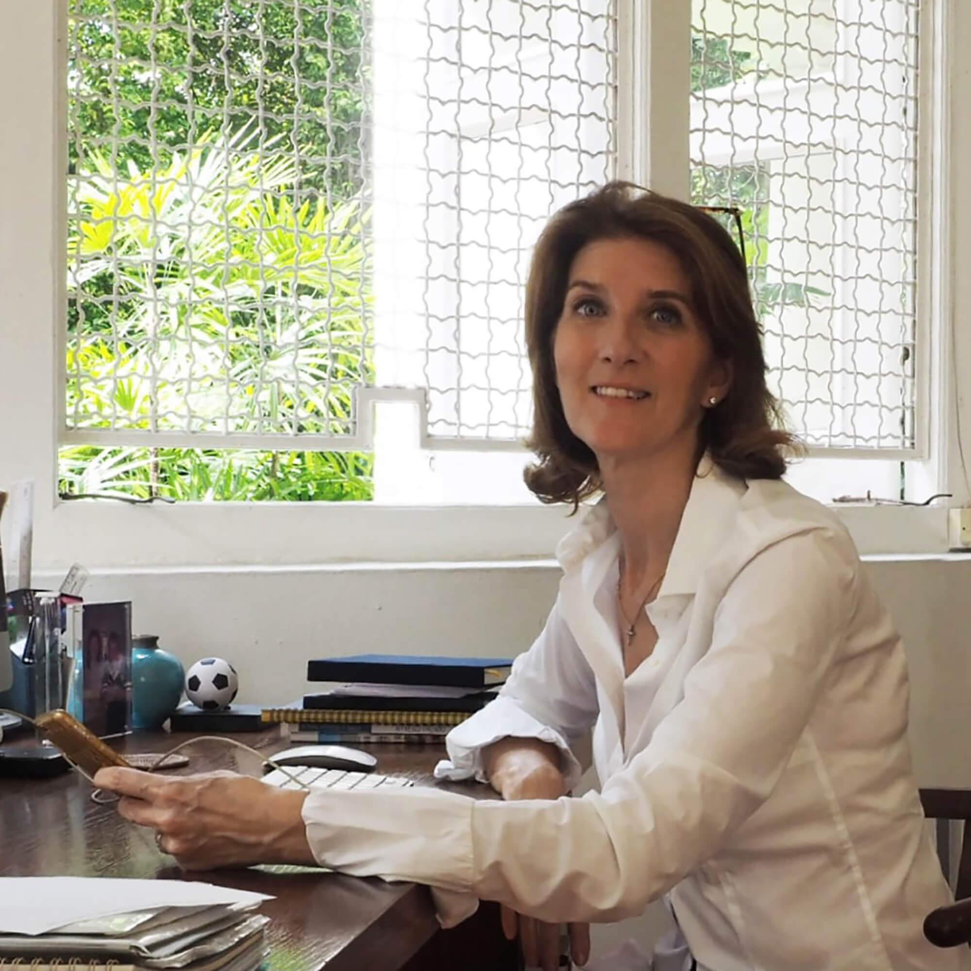 Fiona Henderson sat at her desk