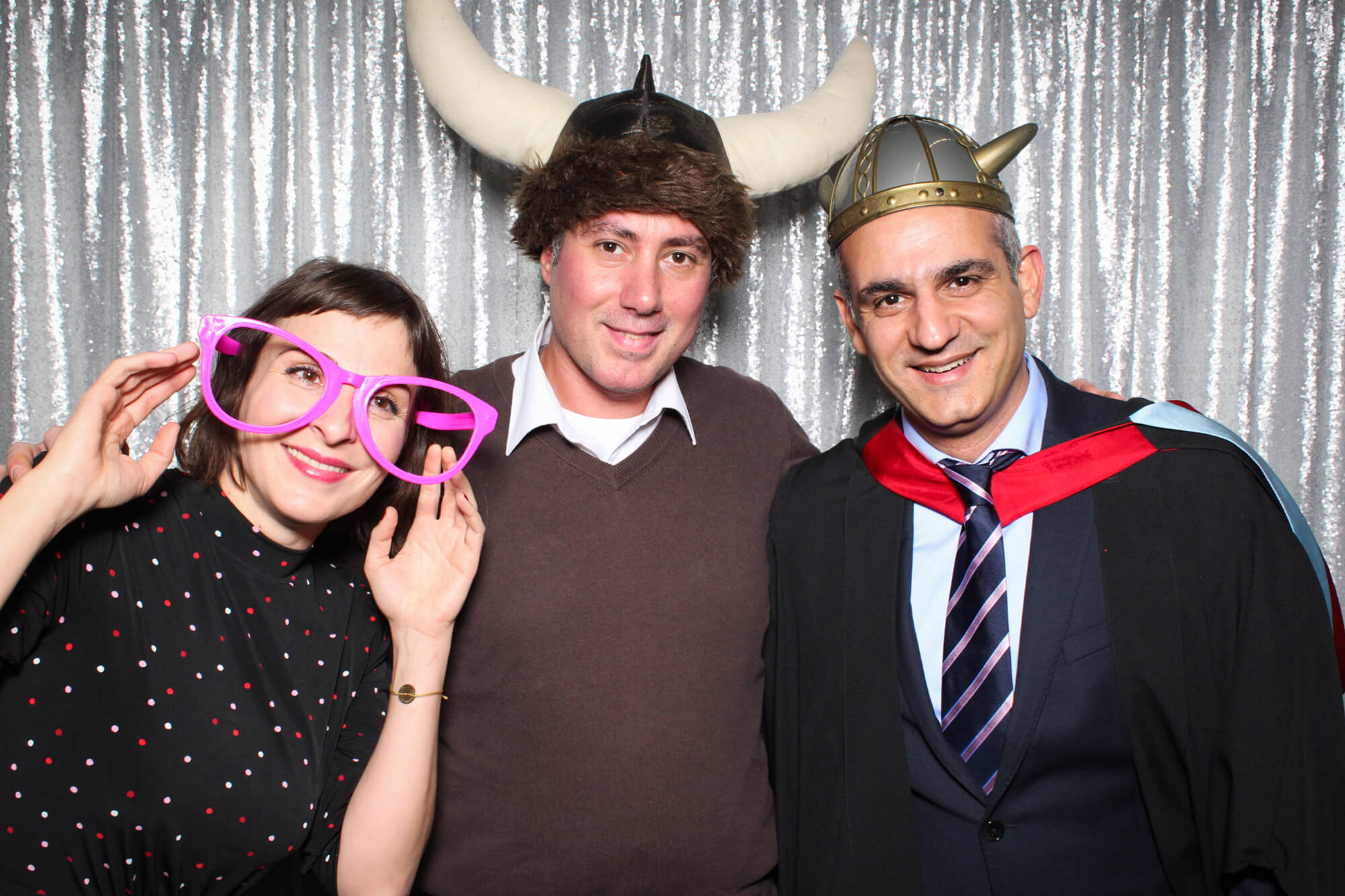 Online student George Papakyritsis at photobooth with friends on his graduation day