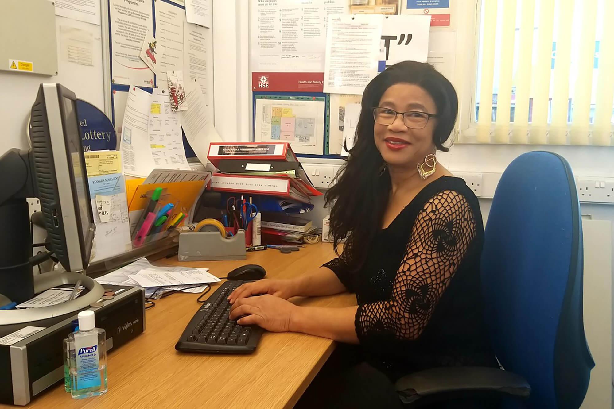 Online student Jackie Ingram sat at her desk working