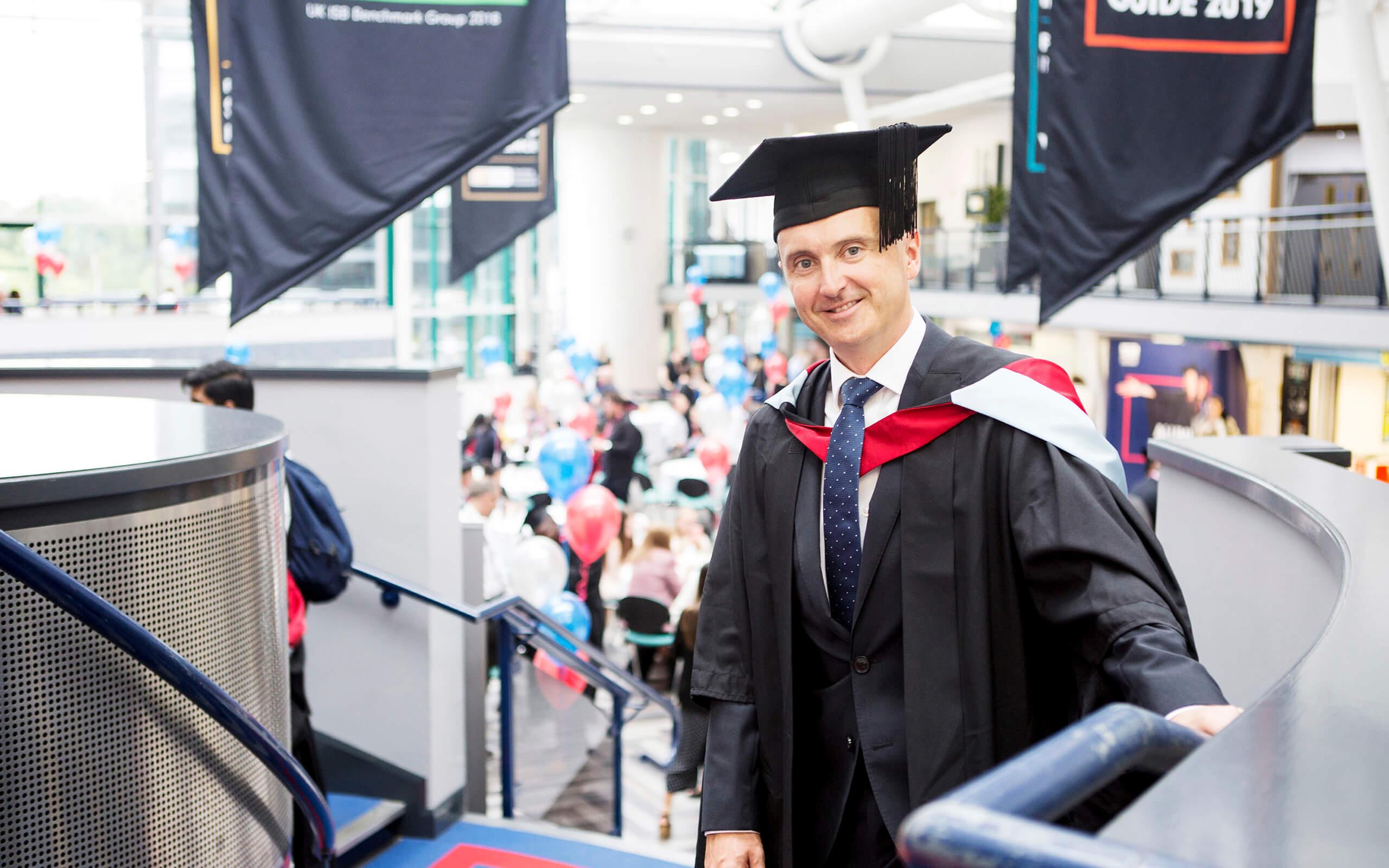 Nick Goddard stood smiling at his graduation