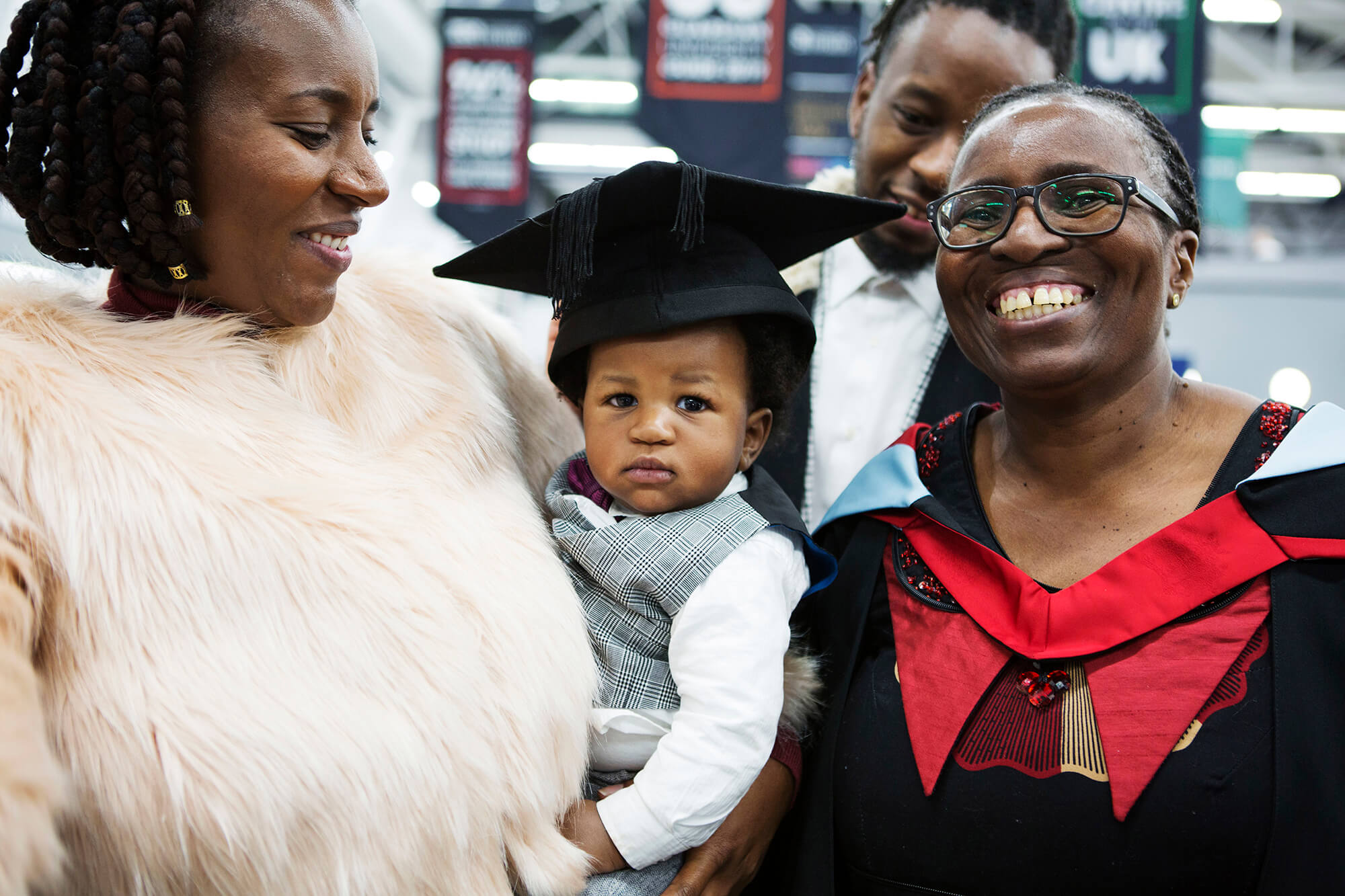 Online student Thobekile Ncube at her graduation reception with her family