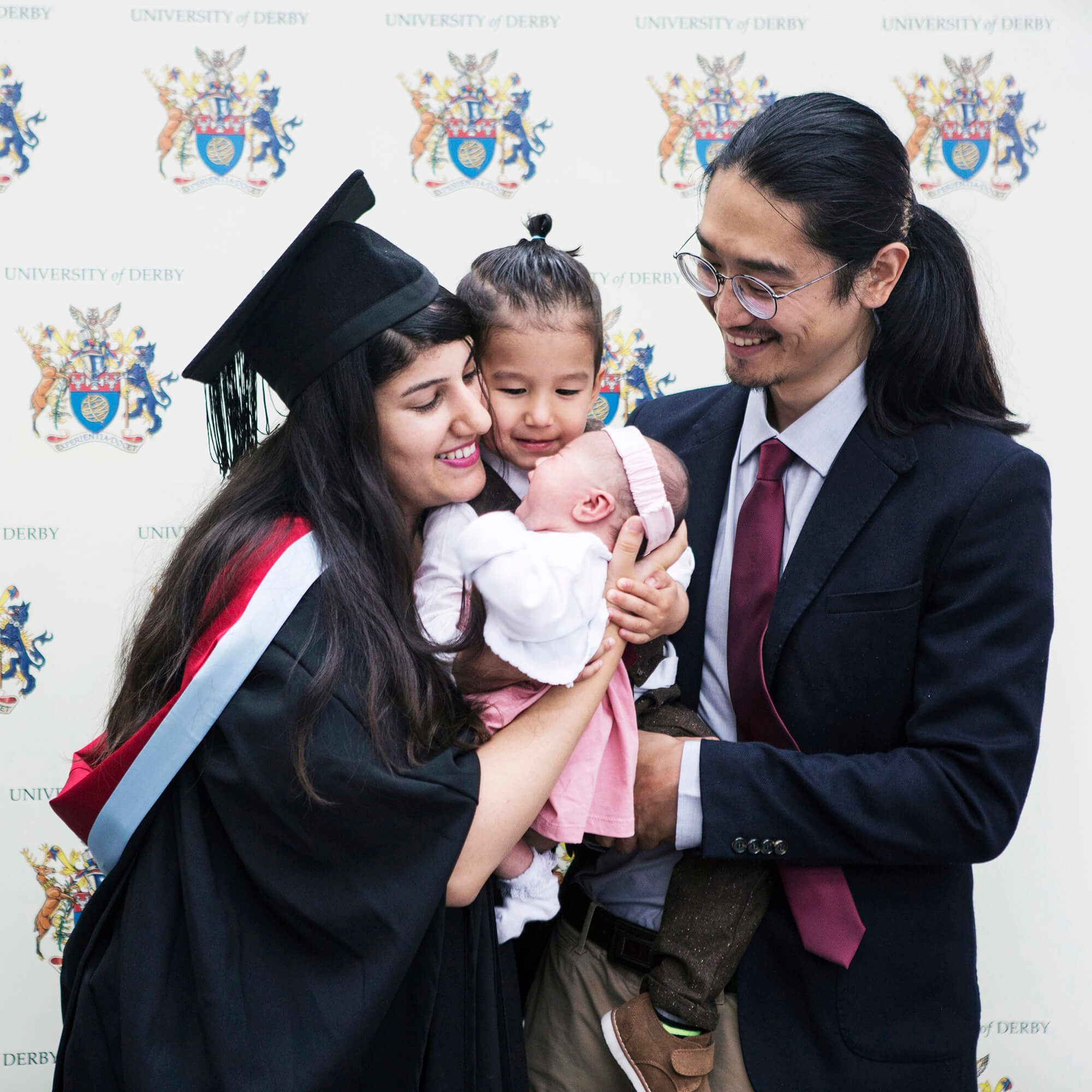 Tyra Johl at her graduation with her two children and husband