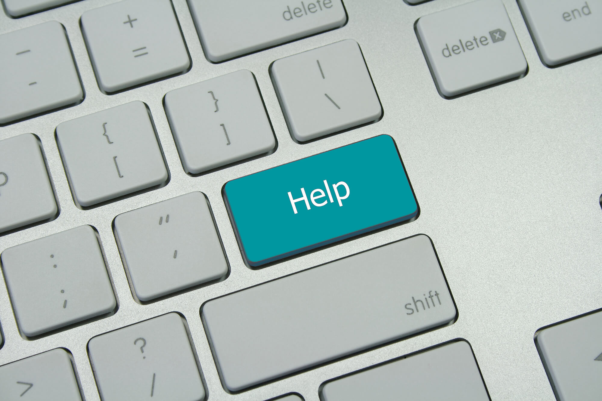 Laptop keyboard with word 'Help' replacing the enter key