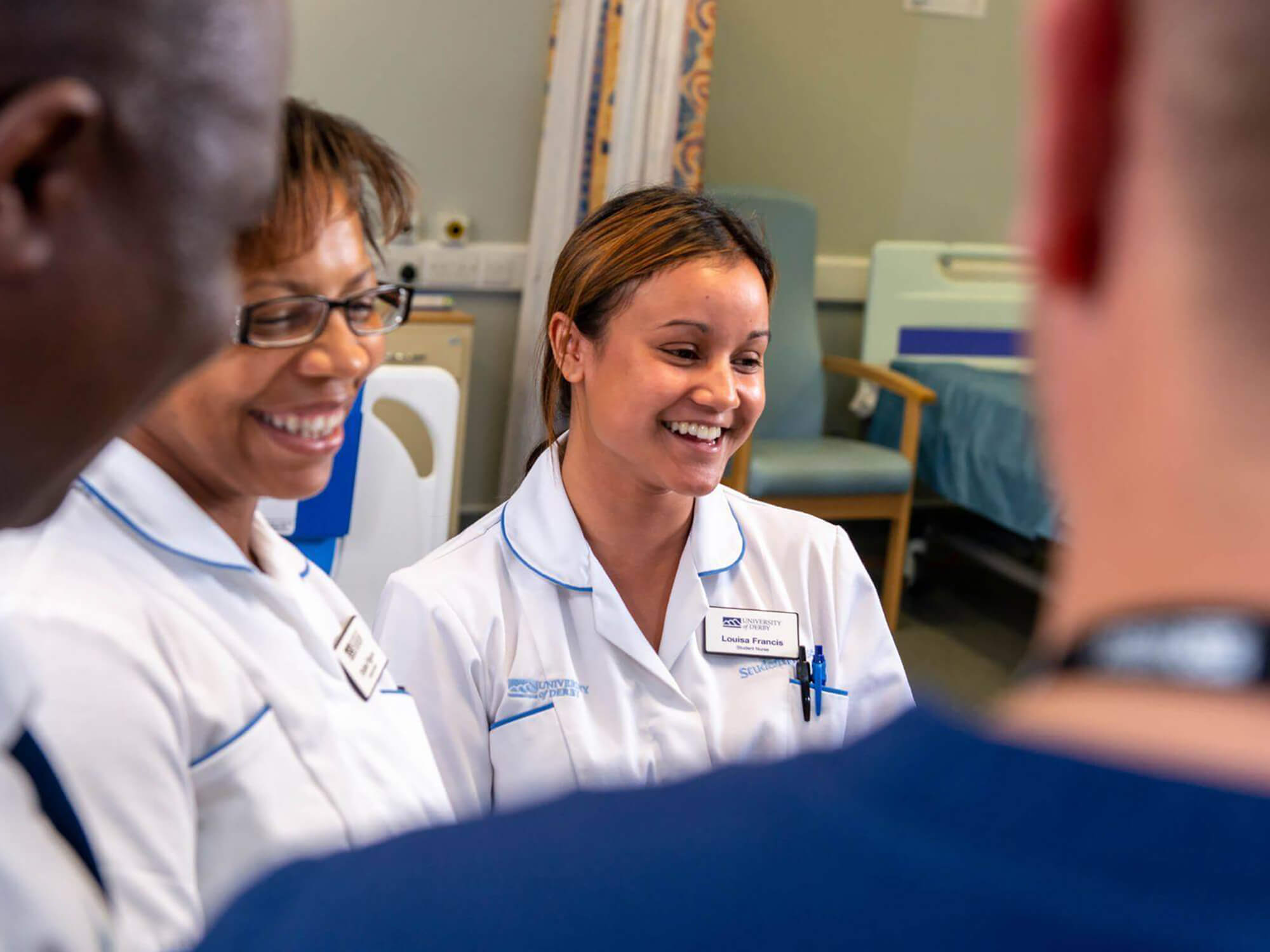 Student nurses standing in group and smiling