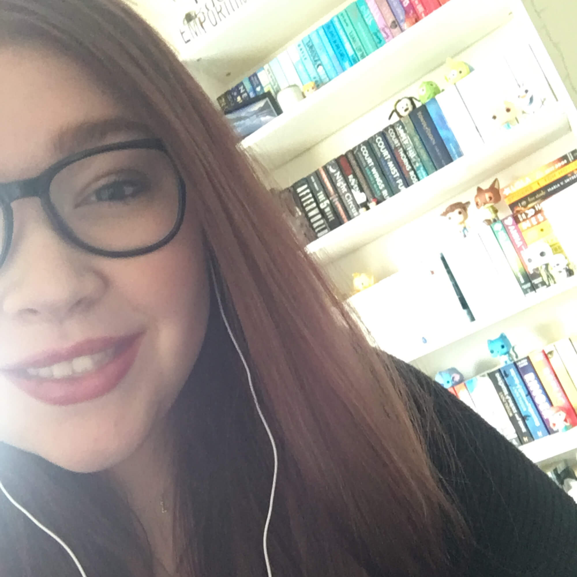 Lauren smiling in front of a bookcase.