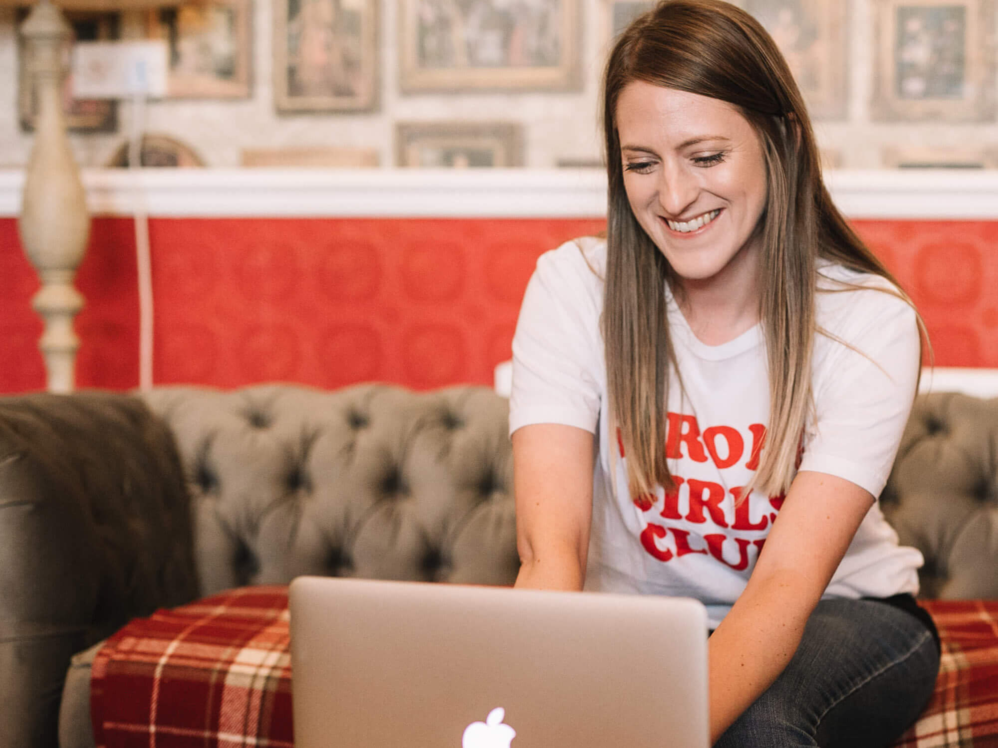 Creative Writing masters graduate Laura Stroud works at her laptop