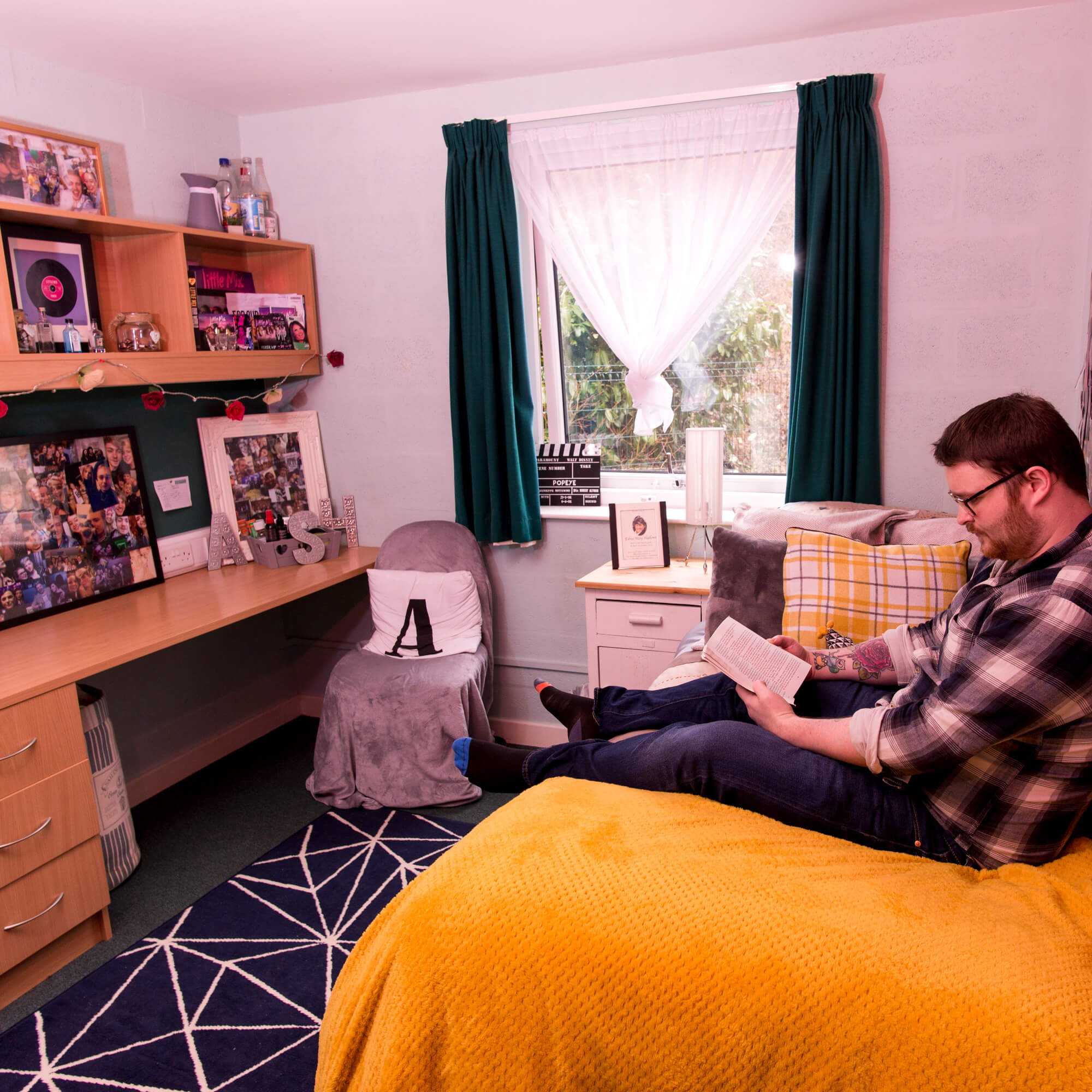A male student sitting in his room in one of the University of Derby's halls