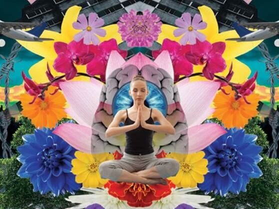 person meditating with flowers in background