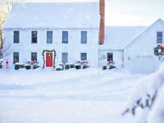 Snowy picture with a house