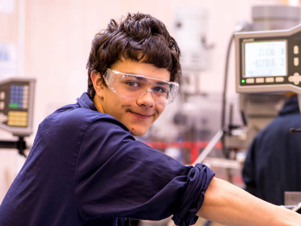 A student working in an apprenticeship industry