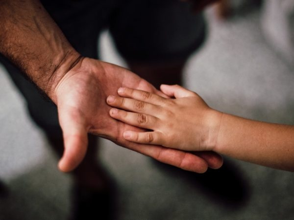 Parent and child hand in hand