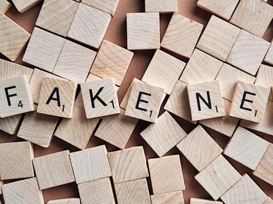 Scrabble tiles spelling fake news