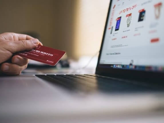 A person using their bank card to shop online