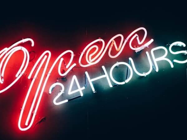 Open 24 hours in neon writing