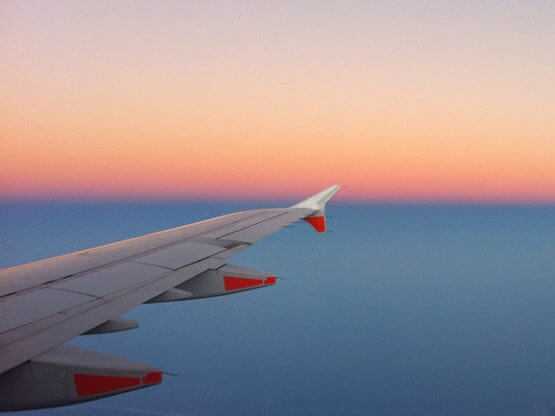 Aeroplane in the sky with a sunset