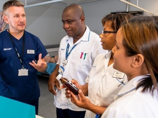 Student nurses talking to each other