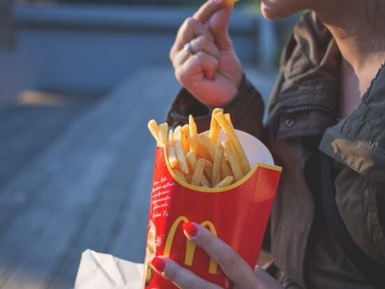 Person eating McDonalds fries