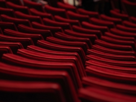 Red rows of cinema seats