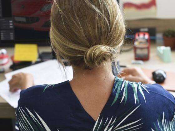 Back of the head of a person with their hair in a bun