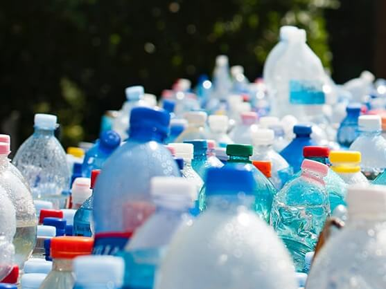 Different coloured plastic bottles being recycled