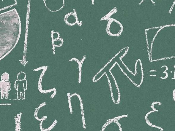 Maths symbols on a blackboard