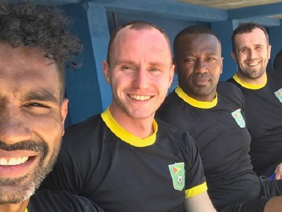 Michael Johnson and Guyana team