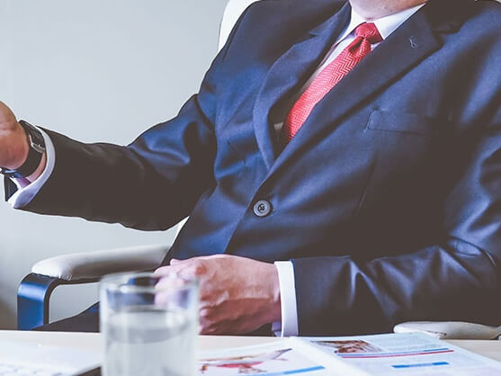 Business person in a suit conducting an interview