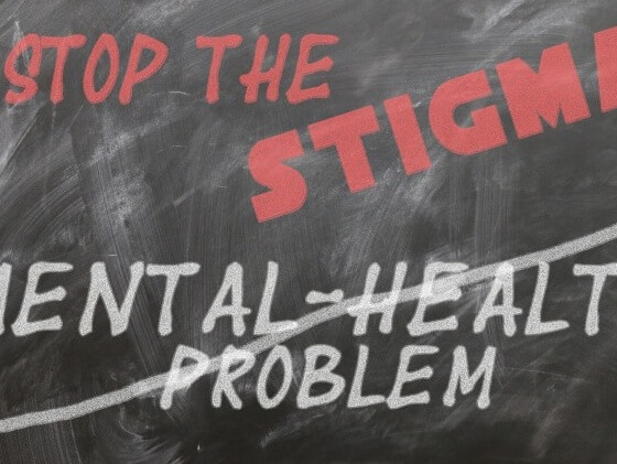 Blackboard that reads 'stop the stigma - mental health problem'
