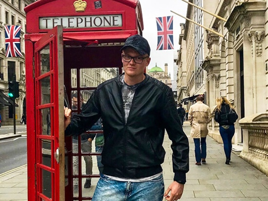 Student in London by red phone box