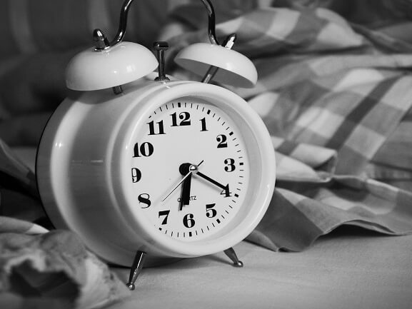 White alarm clock in black and white