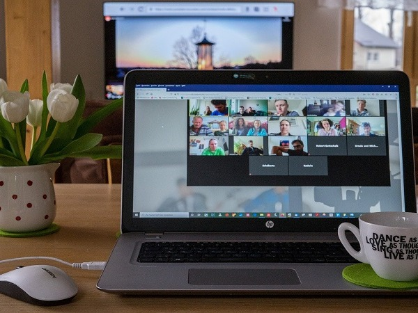 An open laptop on a desk with video conferencing software open on it