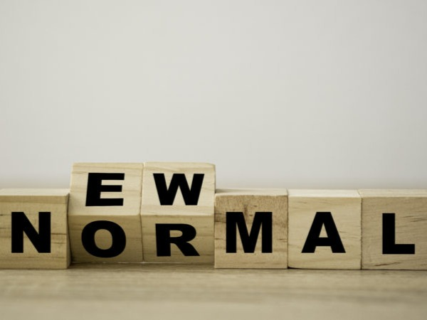 Wooden letter blocks forming the words 'new normal'