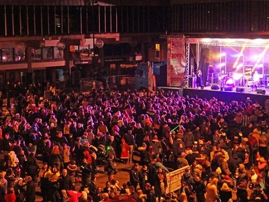Concert filled with people and bright lights