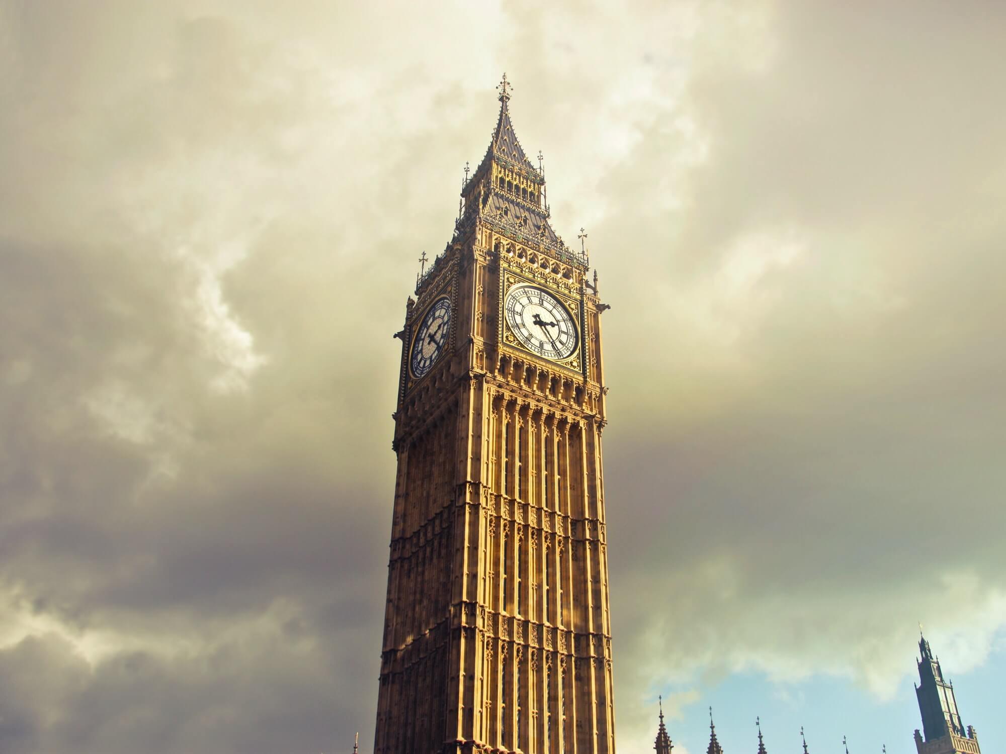 Big Ben in London amongst a grey sky.
