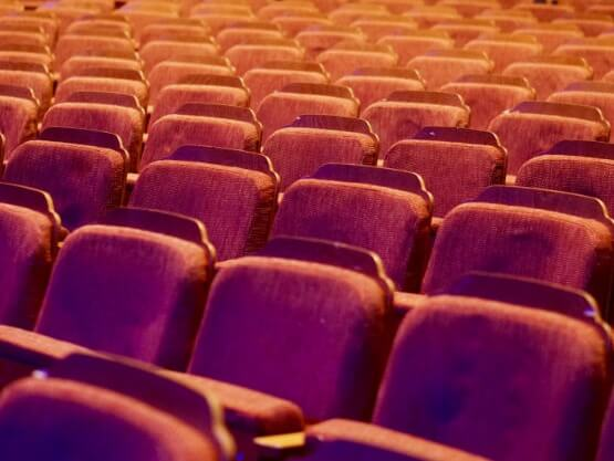 Rows of red cinema/theatre seats