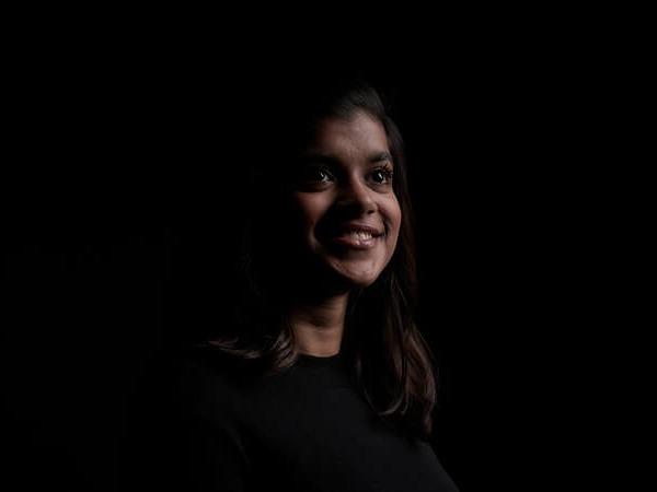 A headshot of Postgraduate Student Manaal Mulla on a black background