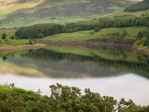 A landscape image of a lake and moorland