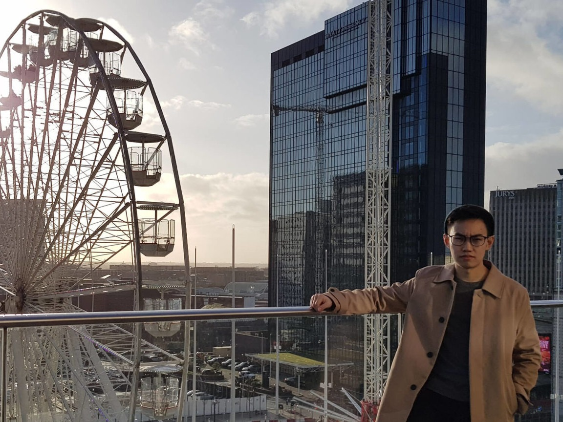 A picture of international student Marcus Chan on a bridge in a city