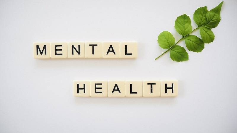 Scrabble tiles laid out to spell mental health