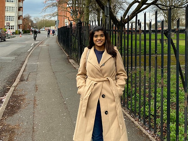 Manaal Mulla standing on a street in Derby outside a park