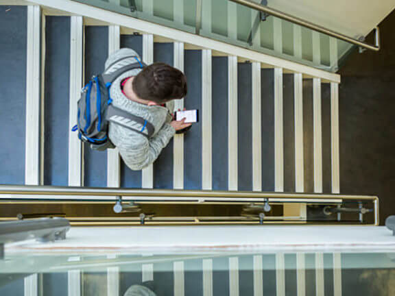 a student walking down a flight of stairs