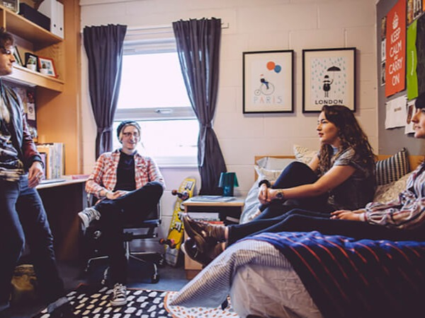A group of four students relaxin an a University of Derby hall residence
