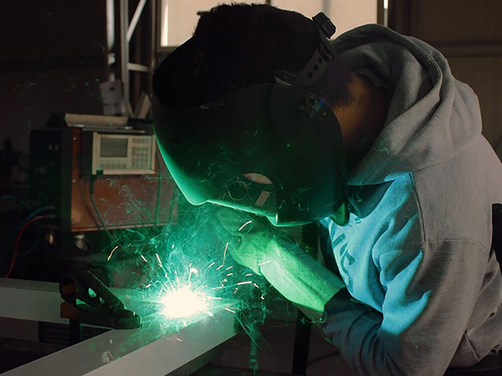 Person wearing a mask whilst welding
