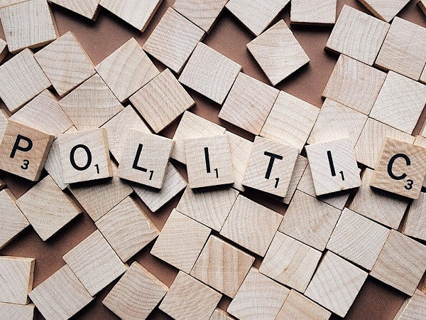 Wooden scrabble blocks spelling 'POLITICS'