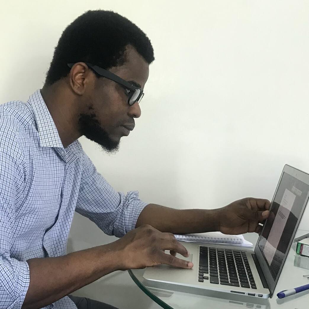 Uchenna Charles Onyema working on a laptop