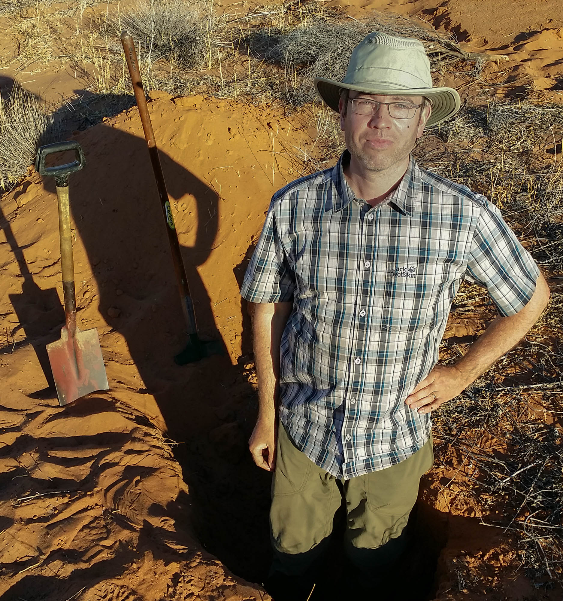 Dr David Elliott sampling soil in central Australia