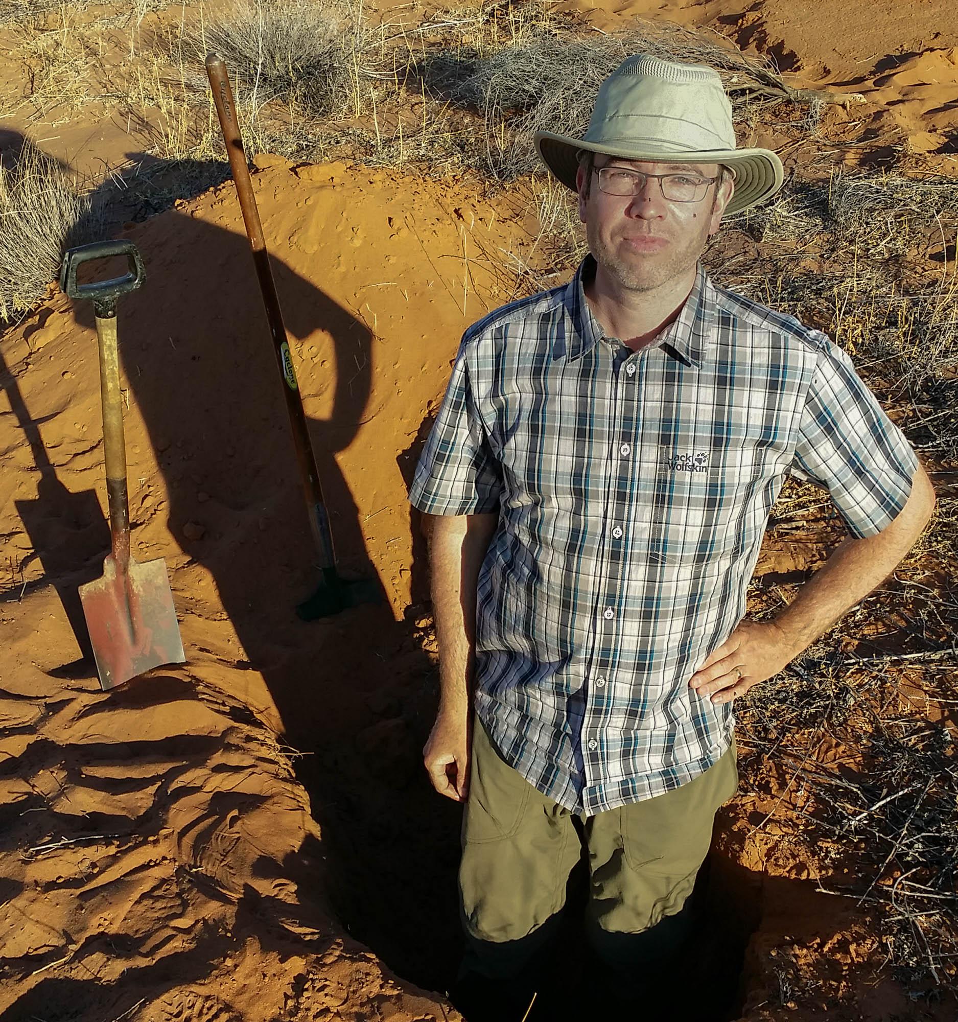 Dr David Elliott sampling soil in central Australia